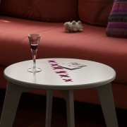 stitched coffee table warm gray paint and fuchsia string