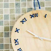 stitched wall clock natural with blue string